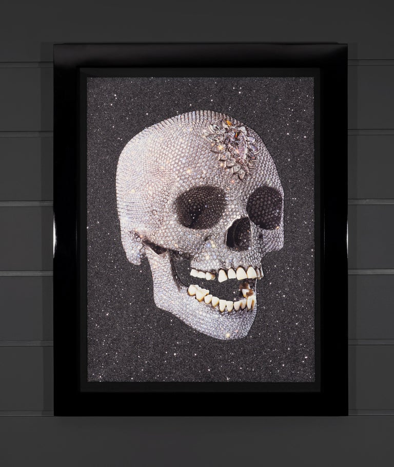 For The Love Of God, 'Laugh' is a glittering silkscreen print with genuine Diamond Dust by Damien Hirst. This artwork depicts one of the most iconic sculptures by Hirst, 'For the Love of God' (2007), a diamond-encrusted platinum skull. Damien Hirst