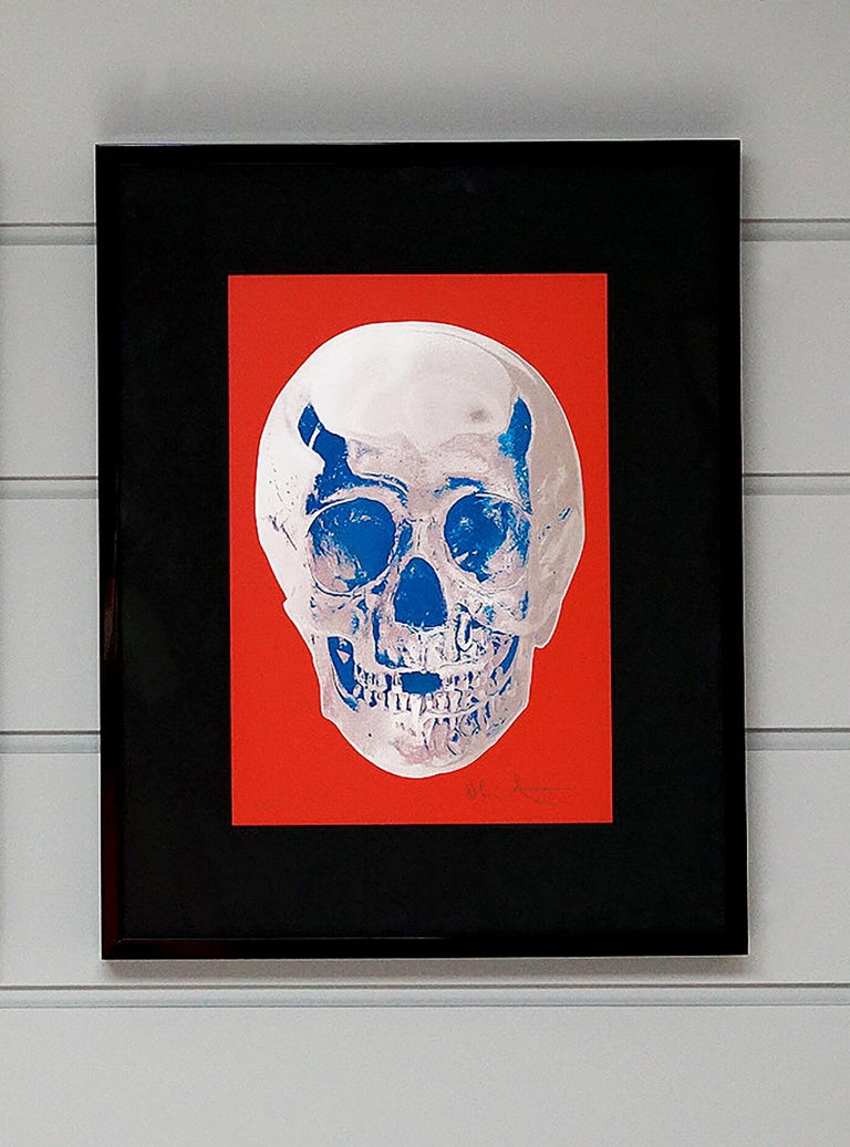 """The red and silver skull entitled """"Till Death Do Us Part"""" is by master contemporary artist, Damien Hirst. The series is created in a small edition of only 50 pieces, signed and numbered by the artist. The printing technique of using silkscreen, foil"""