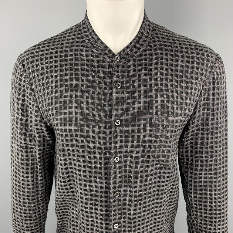 DAMIR DOMA Long Sleeve Shirt comes in black and grey window pane wool / silk material, with a nehru collar, a patch pocket, a buttoned front, buttoned cuffs, vent at sides, in a tunic style. Missing one button at right cuff. Made in Italy.   Good