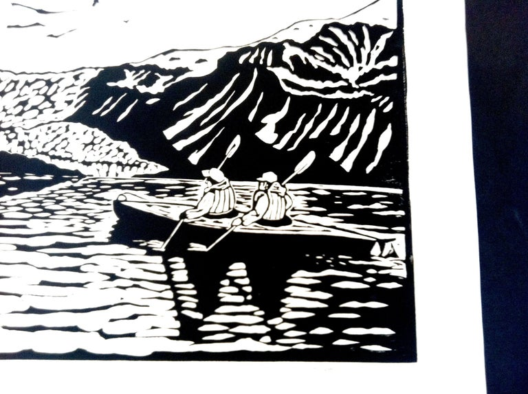 This black and white linocut offers a view of several people paddling in kayaks through the fjords of Aialik Glacier, part of the Kenai Fjords National Park in Alaska. The print gives a sense of the grand scale of the landscape. The artist, Dan