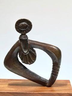 Sun Woman bronze sculpture by Dan Namingha, brown patina, kachina figure