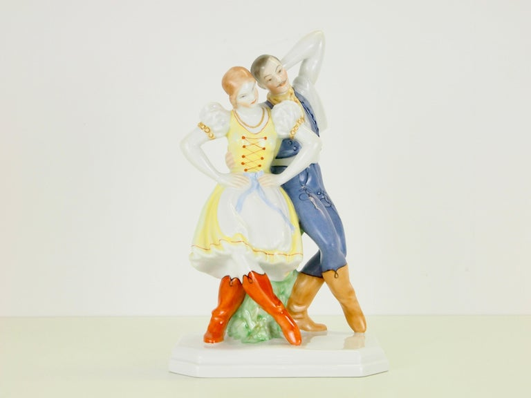 Delicate vintage porcelain statuette depicting a romantic dancing couple manufactured by Herend Hungary.  Herend was founded in 1826 and has had much famous customers who bought it's porcelain. At the first World's Fair the porcelain manufacturer