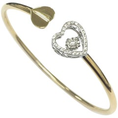 Dancing Diamond Heart Twist Style Bangle 18 Carat Yellow Gold