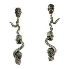 Dangling Snake and Skull Diamond Earring in Silver and Gold