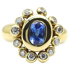 Dangling Sundrops Ring in 18 Karat Yellow Gold with a Tanzanite and Diamonds