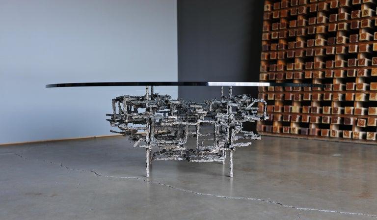 Daniel Gluck sculptural coffee table, circa 1970.   The base measures: 27.75