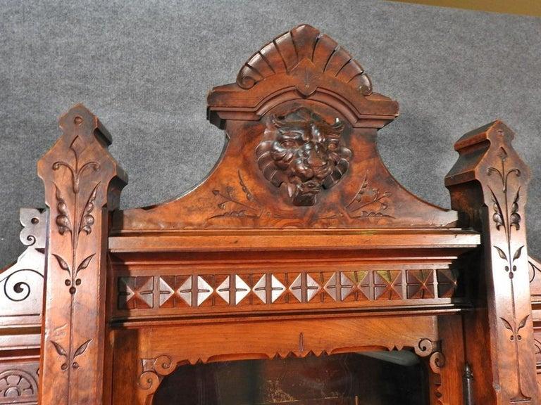 American Daniel Pabst Walnut Renaissance Revival Victorian Three-Door Bookcase circa 1870 For Sale