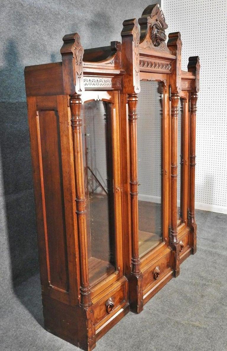 Daniel Pabst Walnut Renaissance Revival Victorian Three-Door Bookcase circa 1870 In Good Condition For Sale In Swedesboro, NJ