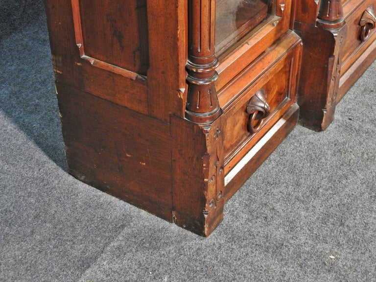 Late 19th Century Daniel Pabst Walnut Renaissance Revival Victorian Three-Door Bookcase circa 1870 For Sale