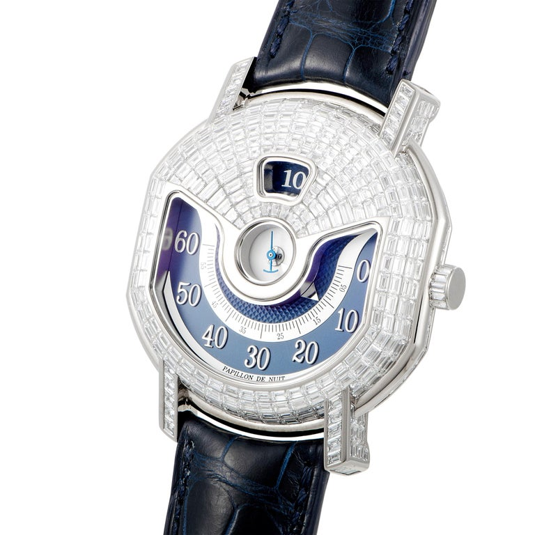 This is a unique Daniel Roth timepiece, presented with a diamond-set 18K white gold case that boasts see-through back. The case is mounted onto a blue leather strap fitted with a diamond-set tang buckle. Powered by a self-winding movement, this