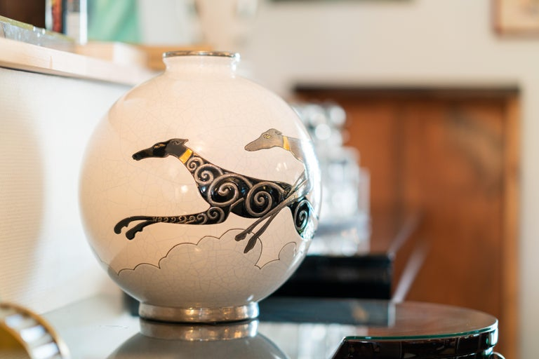 Emaux de Longwy ceramic vase with craqueling glaze White body with greyhounds  Limited edition of 50 objects   Danillo Curetti (1953-1993) was one of the first great names in the contemporary creations of Les Emaux de Longwy. The edition of this