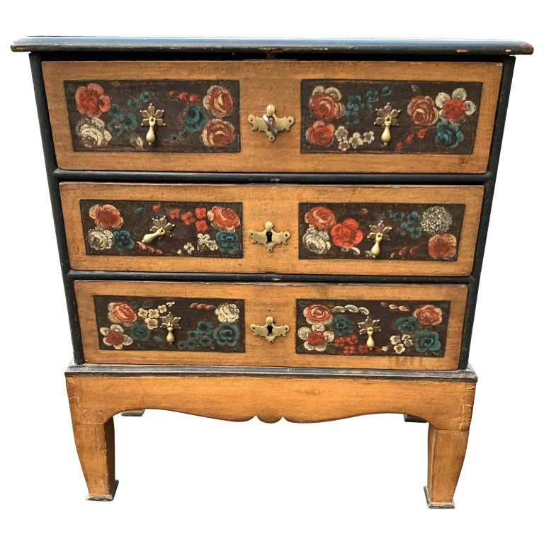 Danish 18th century painted Folk Art chest of drawers.  The chest has three drawers and original hardware and locks with one key.