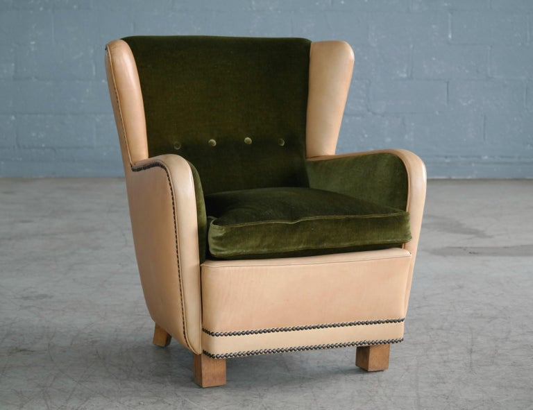 Superb and unique Classic Danish 1940s club chair in the style of Fritz Hansen. The chair has a nice stance and strong presence and is solid and sturdy while being superbly comfortable. The chair has been expertly re-upholstered at a later point in