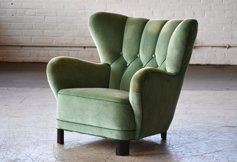 Incredibly comfortable, exuberant designed high back lounge chair in the style of Flemming Lassen and bearing some resemblance to his famous