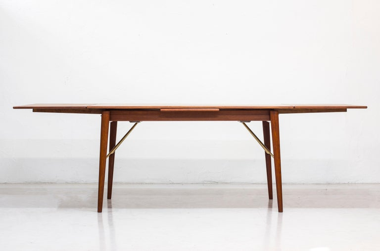 Dining table designed by Peter Hvidt & Orla Mølgaard Nielsen. Produced in Denmark by Søborg Furniture during the 1950s. Made from teak wood with brass details. Dutch style inlays. Good vintage condition with some age related wear and