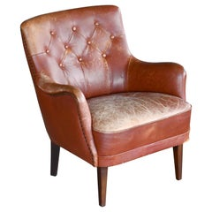 Danish 1950s Small Scale Tufted Easy Chair with Worn Brown Leather