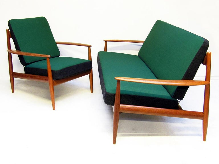 A 1950s model FD-118 two-seat sofa and lounge chair in teak and Kvadrat fabric by Grete Jalk for France and Daverkosen.   The earliest edition of this design, they have an elegant and streamlined form.   They have been carefully restored and