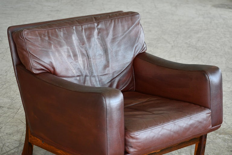 Mid-Century Modern Danish 1960s Lounge Chair in Brown Leather and Rosewood by Erhardsen & Andersen For Sale