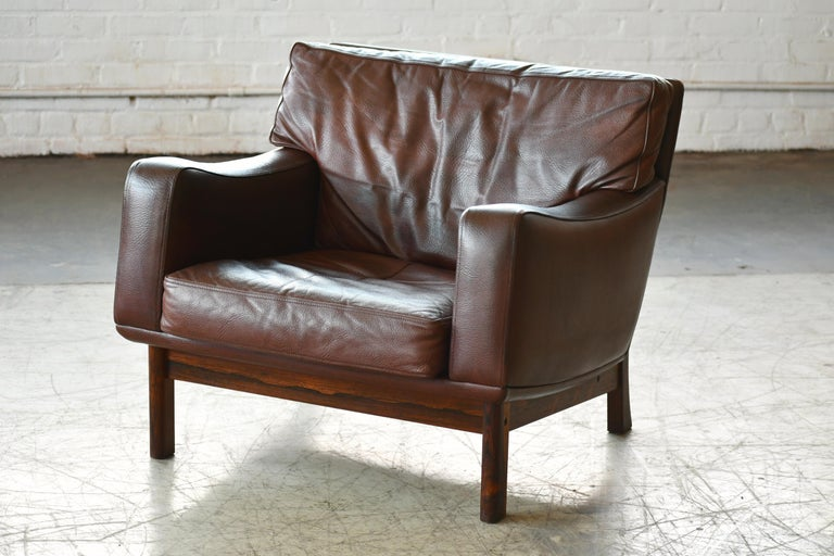 Mid-20th Century Danish 1960s Lounge Chair in Brown Leather and Rosewood by Erhardsen & Andersen For Sale