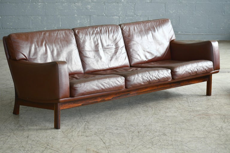 Mid-Century Modern Danish 1960s Sofa in Brown Leather and Rosewood by Erhardsen & Andersen For Sale