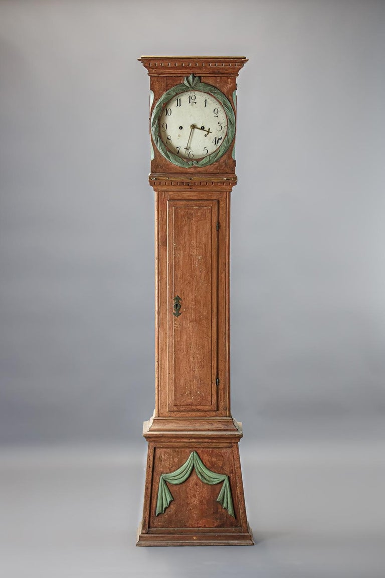 Early 19th century Danish clock, original painted finish, intricate wood carving. Appears internals have been updated and replaced, sold as decorative only, but mechanics, weights and pendulum all present.