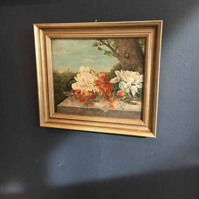 Beautiful small Danish still life of flowers resting on stone wall, with a trees and windmill and a small church visible in the distance. Oil on mahogany board. Signed and dated S.D. Espe 55.  Listed dimensions without frame.