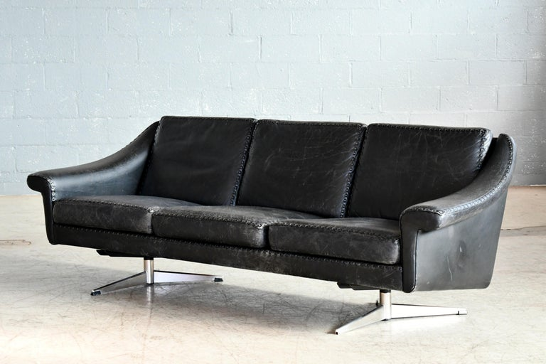 Elegant three seat leather sofa model Matador from 1966 designed by Aage Christiansen in the mid-1960s and produced by Erhardsen & Andersen, Denmark. Upholstered in supple black ox hide leather on a steel l base. Super elegant highest quality with