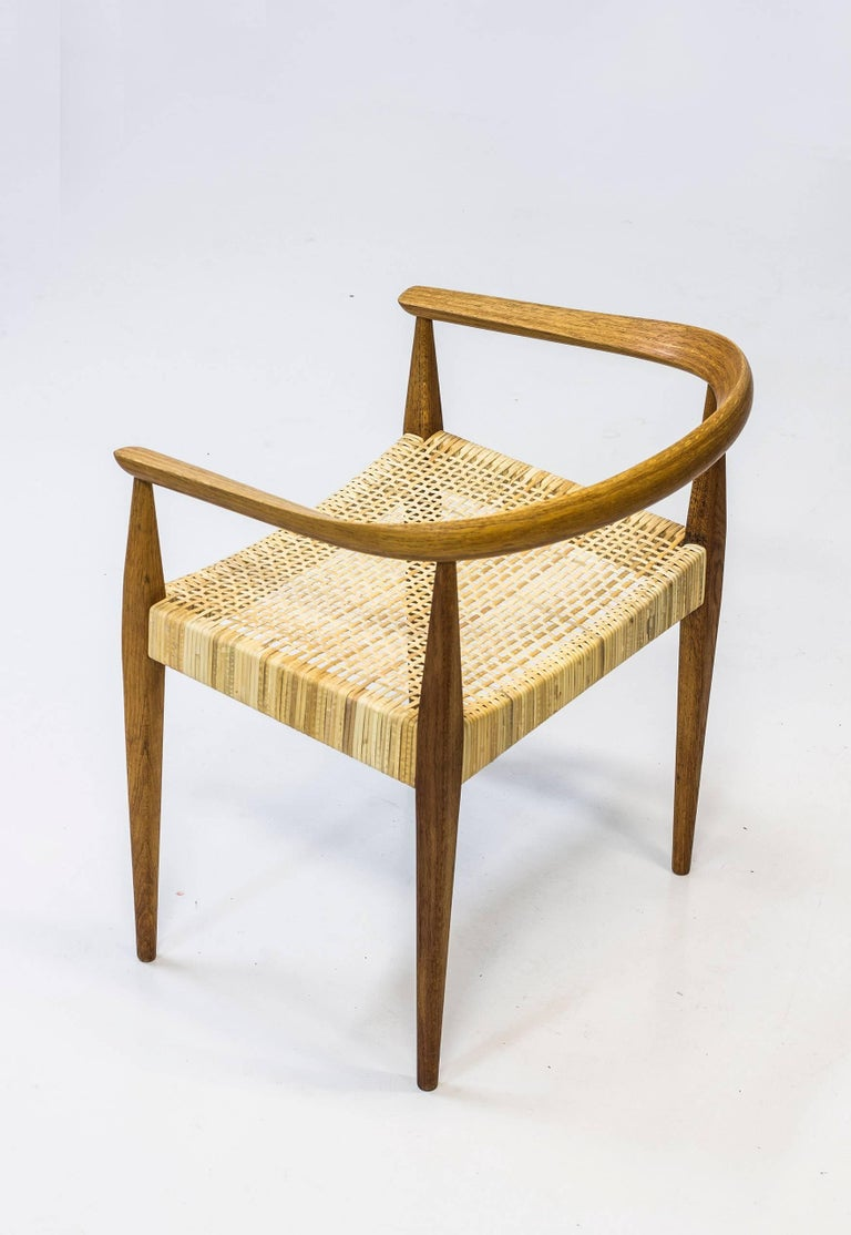 Rare armchair model no 113 designed by Nanna Ditzel. Produced in Denmark by Poul Kolds Savværk ca 1955-1960. Made from solid oak and laminated oak in the backrest. Seat in hand woven rattan. Excellent condition with very few signs of use and very