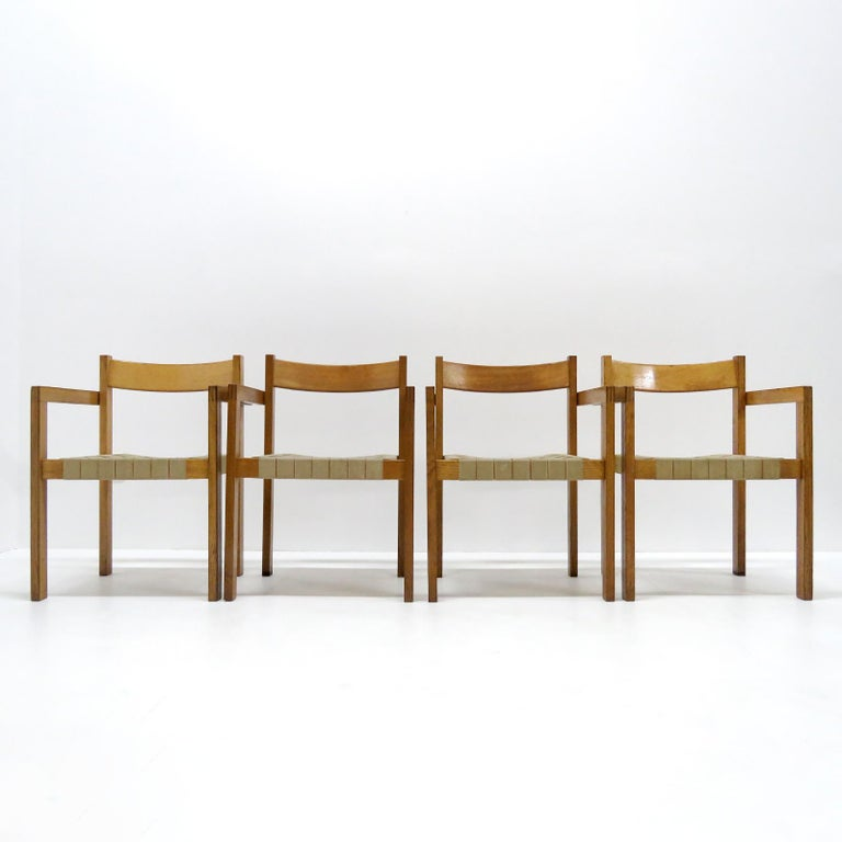 Wonderful 1960s dining chairs by Hans Wegner for GETAMA, with arms, in oak with straps of hemp, great patina, very comfortable. Priced individually. 3 chairs available.