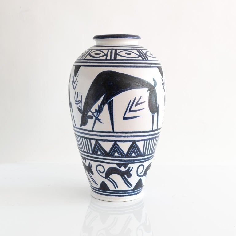 A large-scale, hand decorated vase by Danish artist Mette Doller for the Swedish company Andersson & Johansson - Höganäs Ceramic, circa 1950s. The vase depicts grazing deer and geometric patterns. Vases are not drilled but could be converted to