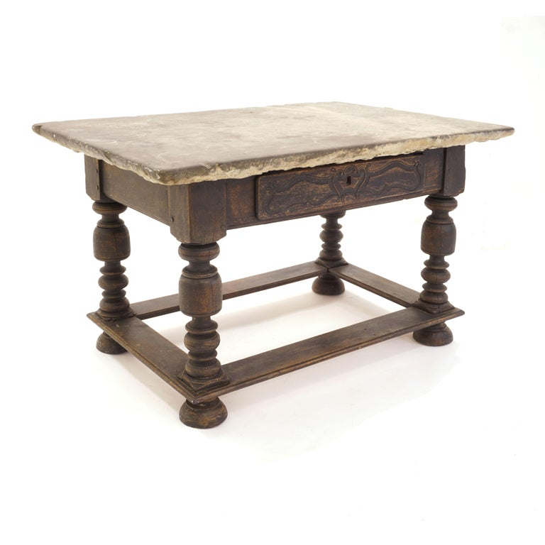 Danish Baroque stone table with grey stone top above black painted lower part