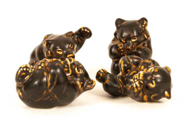Danish bear cubs figurines by Knud Kyhn for Royal Copenhagen 1950s Set of 4.  Ceramic figurines designed by Danish ceramist Knud Kyhn, Models no: 21432, 21433, 21434 and 21435.  Perfect condition, 1. factory quality. No chips or cracks.