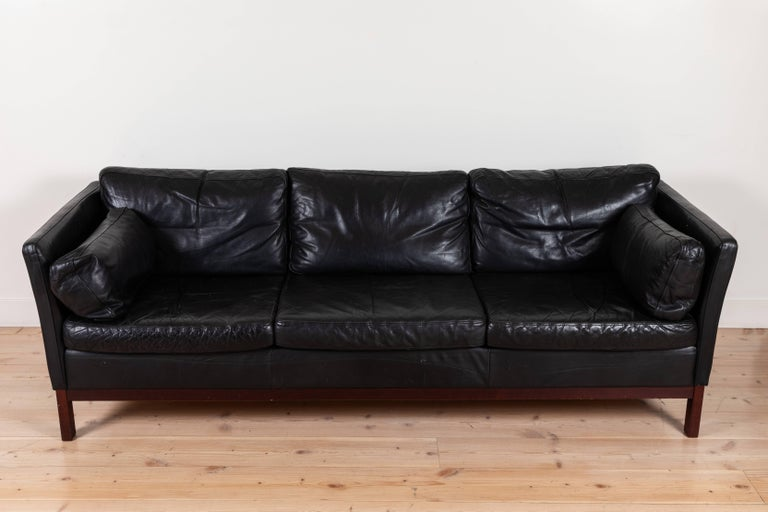 Danish black leather sofa by Mogens Hansen.