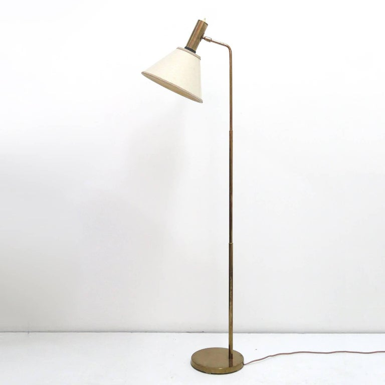 Minimal Danish brass floor lamp by Bergboms with original linen shade, on/off switch on top of the brass cylinder.