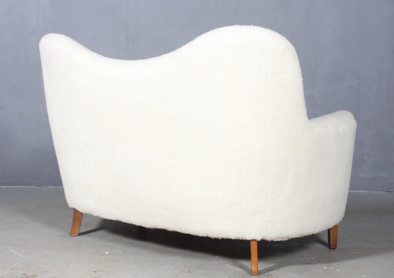 Danish cabinetmaker love seat sofa new upholstered with lambwool.  Legs of beech  Made in the 1940s.