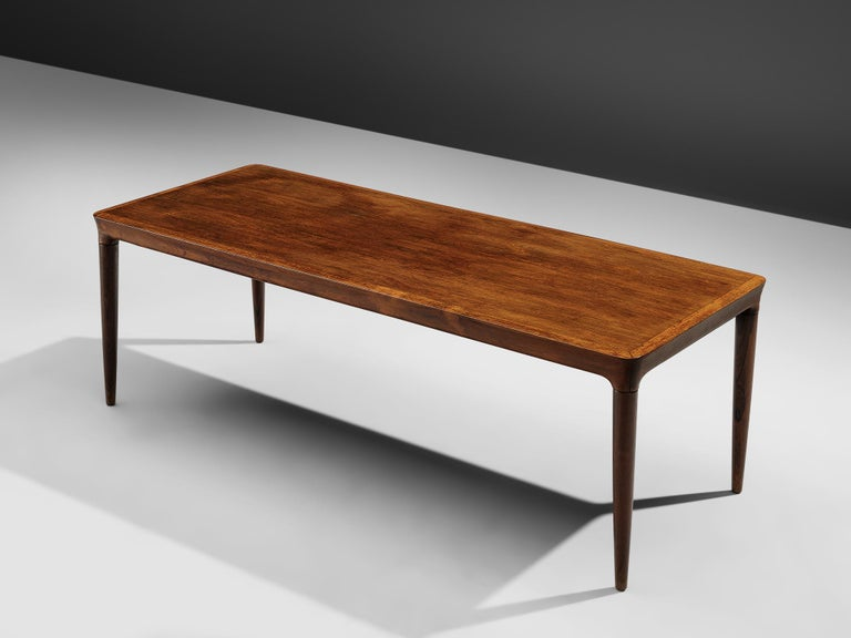Coffee table, rosewood, Denmark, 1960s  Rectangular coffee or side table in rosewood, the tabletop shows beautifully grained rosewood finer. The rounded edges and tapered legs give this Danish side table an elegant and timeless look. An excellent