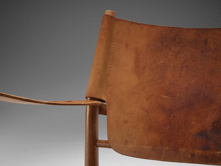 Mid-20th Century Danish Cognac Leather Safari Chairs, 1950s For Sale