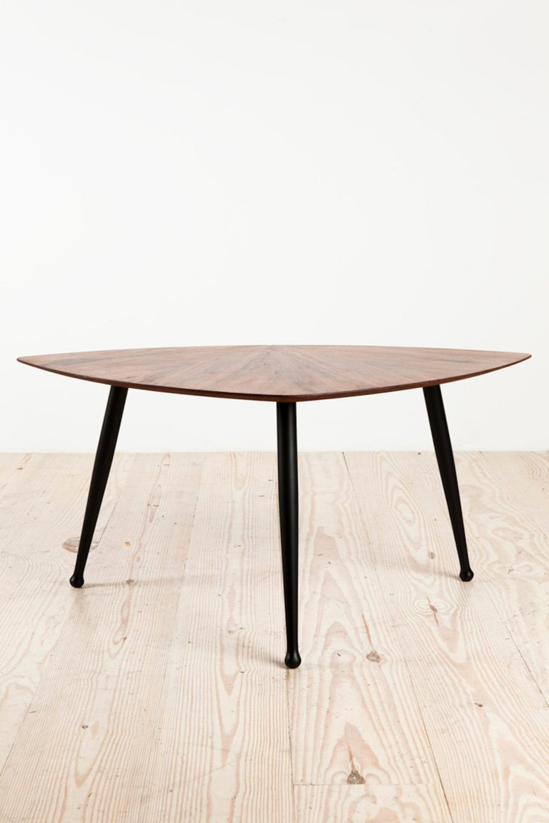 Danish midcentury Craftsman tripod base coffee table, rosewood veneer top with ebonized legs, origin: Denmark, circa 1960.
