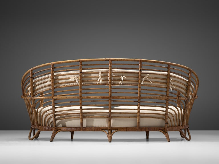 Mid-20th Century Danish Curved Rattan Sofa with Eggshell White Upholstery For Sale