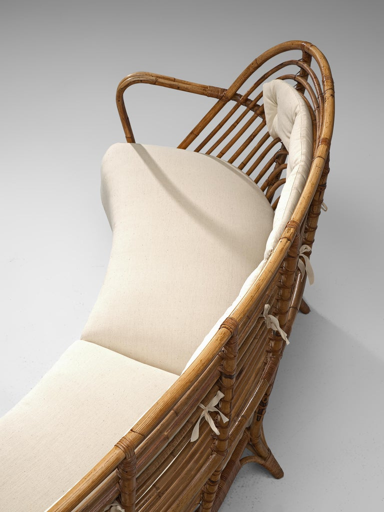 Danish Curved Rattan Sofa with Eggshell White Upholstery For Sale 1