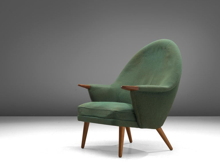 Lounge chairs, oak and fabric, Denmark, 1960s  Scandinavian Modern lounge chair in the style of Wegner's Mama bear chair. This lounge chair has an open expression and an elegant shape due to its round shapes. The high, rounded backrest is