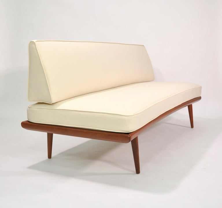 This Minerva FD 417 sofa was designed by Peter Hvidt & Orla Mølgaard-Nielsen and produced in the 1950s by France & Daverkosen (later renamed France & Son) in Denmark. It is made of solid teak and features new upholstery in an off-white / light cream