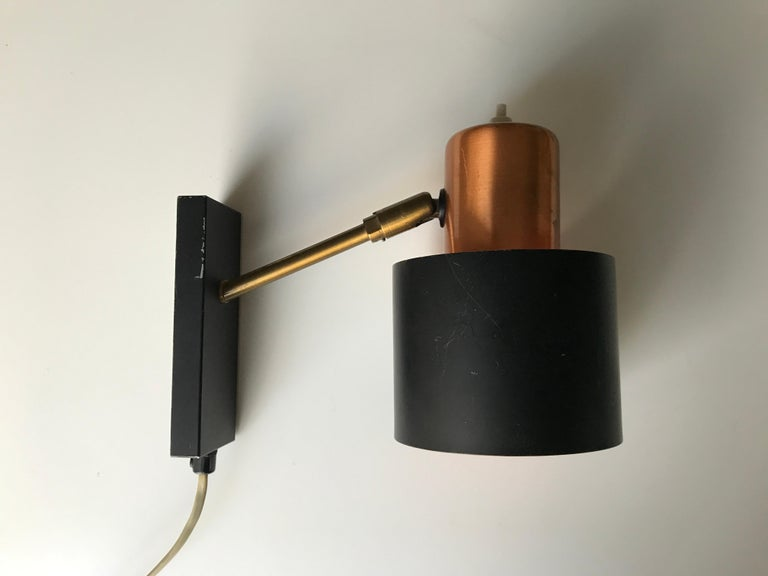 Midcentury Danish design wall light design by Jo Hammerborg. Copper and black matte surface. Typically orange surface inside shade. Manufactured by late Danish factory Lyfa. E14 bulb socket holder. Original condition. New cable can be fitted without