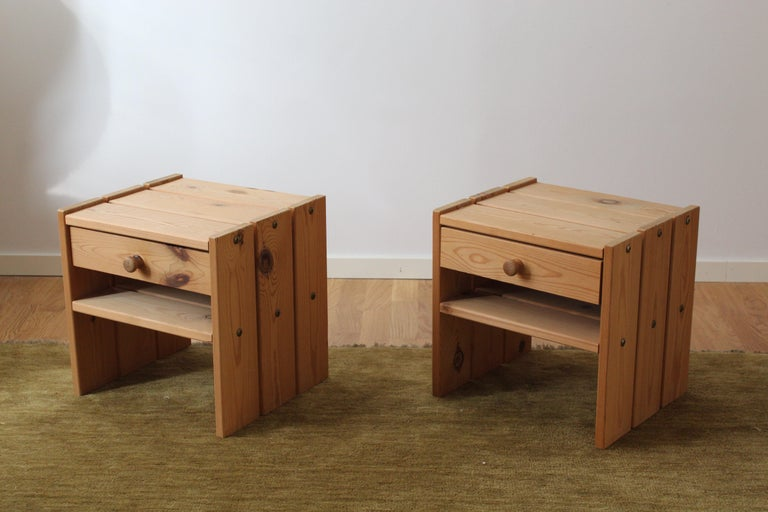 A set of bedside cabinets / tables / nightstands. Designed and produced in Denmark, 1970s. In solid pine.  Other designers working in similar style and materials include Axel Einar Hjorth, Roland Wilhelmsson, Pierre Chapo, and Charlotte Perriand.
