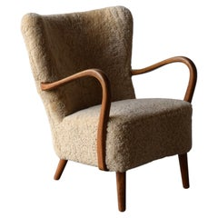 Danish Designer, Organic Lounge Chair, Sheepskin, Wood, Denmark, 1940s