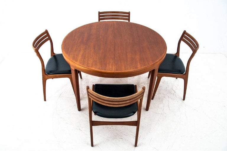 Dining set, Denmark, 1960s  Very good condition of the set. After professional restoration of the wood, the chairs are upholstered with a new fabric.  Table designed by Johannes Andersen.  Wood: Teak  Dimensions:  Table 74 cm high,