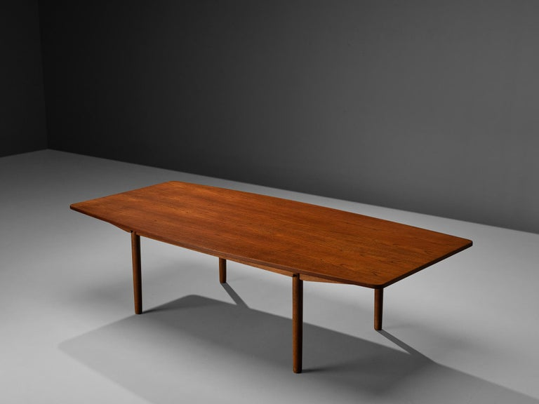 Danish dining table, teak, brass, Denmark, 1950s  This dining table was designed and manufactured in Denmark in the 1950s. The rectangular shape of the top widens at the long sides, therefore a boat-shape is evoked. This feature but also the rounded