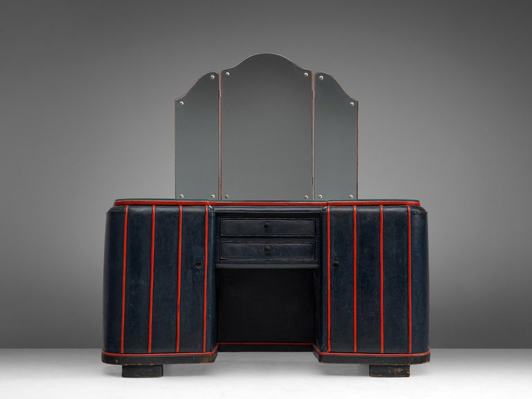 Dressing table in leather, Danish, 1940s.  This dressing table was made in dark blue leather and red top. The red details in the original upholstery form a strong contrast to the marine blue leather. The top features a folding mirror in which is