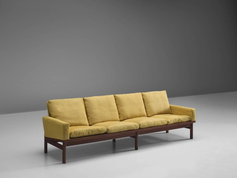 Settee, fabric and dark grained wood, Denmark, 1960s  This high quality sofa features thick cushions and a simplistic, geometric solid wooden frame. The sofa has eight legs and a tilted backrest in order to provide maximum comfort. Due to the high