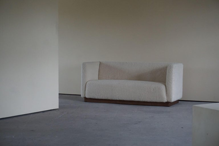 Elegant freestanding Art Deco 3-seater sofa reupholstered in sheep skin, frame made in oak. Made in 1930s by a Danish cabinetmaker.  Mentionable designers from this Danish era is; Flemming Lassen & Kaare Klint among others.